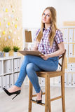 Businesswoman on stool Royalty Free Stock Photography