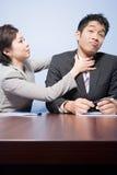Businesswoman strangling businessman Royalty Free Stock Image
