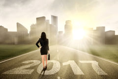 Businesswoman with 2017 on the street Royalty Free Stock Photo