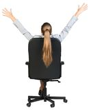 Businesswoman stretching in the chair of her Stock Photography