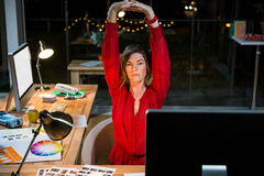 Businesswoman stretching hands in office Royalty Free Stock Photos
