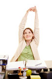 Businesswoman stretching at her Stock Photos