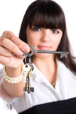 Businesswoman stretching keys Royalty Free Stock Photos