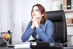 Businesswoman striving for a solution to a problem Stock Photos