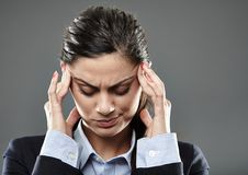 Businesswoman with strong migraine Stock Photos