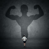 Businesswoman and strong shadow 3 Stock Image