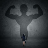 Businesswoman and strong shadow 1 Royalty Free Stock Image
