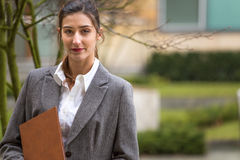 Businesswoman or student outside. Businesswoman or student looking at camera outdoor Royalty Free Stock Image