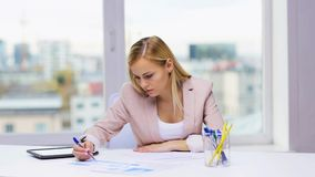 Businesswoman or student with papers tablet pc stock video footage