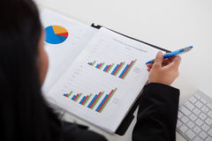 Businesswoman Studying Graph Royalty Free Stock Photo