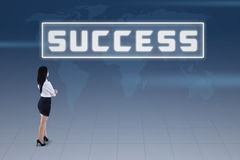 Businesswoman and success concept on blue world map Royalty Free Stock Photos