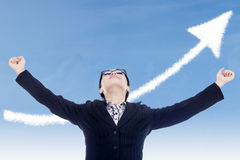 Businesswoman success gesture with up arrow cloud Stock Image