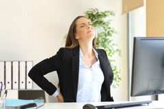 Businesswoman suffering back ache Stock Image