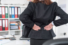 Businesswoman suffering from back pain Royalty Free Stock Images