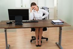 Businesswoman Suffering From Backache And Headache Stock Photo