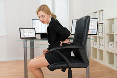 Businesswoman Suffering From Backache In Office Stock Images