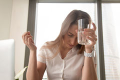 Businesswoman Suffering From Headache At Workplace Stock Images