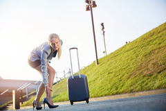 Businesswoman suffering from leg sore. On business trip Stock Images