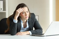 Businesswoman suffering migraine at office royalty free stock photography