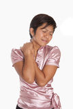 Businesswoman suffering from shoulder ache Stock Photo