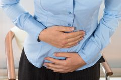 Businesswoman suffering stomachache Royalty Free Stock Photos