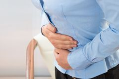 Businesswoman suffering stomachache Royalty Free Stock Images