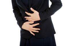 Businesswoman suffering from stomachache. Royalty Free Stock Photography