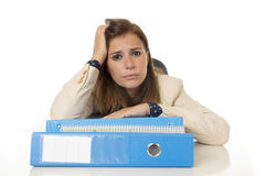 Businesswoman suffering stress and headache at office desk looking worried depressed and overwhelmed Royalty Free Stock Photography