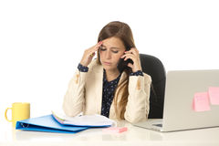 Businesswoman suffering stress at office computer desk looking worried depressed and overwhelmed Royalty Free Stock Photography