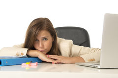 Businesswoman suffering stress at office computer desk looking worried depressed and overwhelmed Stock Photo