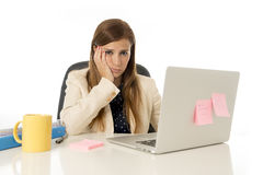 Businesswoman suffering stress at office computer desk looking worried depressed and overwhelmed Royalty Free Stock Photo