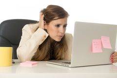 Businesswoman suffering stress at office computer desk looking worried depressed and overwhelmed Stock Images