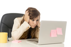 Businesswoman suffering stress at office computer desk looking worried depressed and overwhelmed Royalty Free Stock Photos