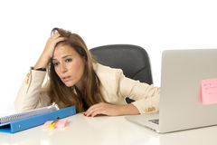 Businesswoman suffering stress at office computer desk looking worried depressed and overwhelmed Stock Photos