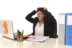Businesswoman suffering stress working at office computer desk worried desperate Royalty Free Stock Image