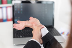 Businesswoman suffering from wrist pain Royalty Free Stock Photo