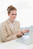 Businesswoman suffering from wrist pain in office Royalty Free Stock Photography
