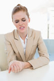 Businesswoman suffering from wrist pain Stock Photography