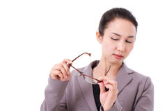 Businesswoman suffers from poor eyesight Royalty Free Stock Images