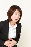 Businesswoman suffers from stomachache Royalty Free Stock Images