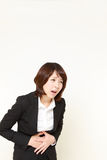 Businesswoman suffers from stomachache Stock Images