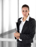 A businesswoman in a suit. A businesswuman in a suit before window Royalty Free Stock Photo