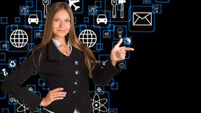 Businesswoman in suit and application icons Royalty Free Stock Photo
