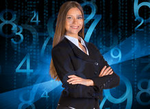Businesswoman in a suit. Blue glowing figures Stock Photos