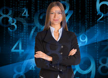 Businesswoman in a suit. Blue glowing figures Stock Photo