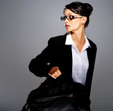 Businesswoman in suit with briefcase Royalty Free Stock Images