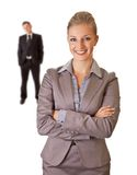 Businesswoman in suit with businessman isolated Stock Images