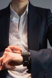 Businesswoman in suit checking the time Royalty Free Stock Photo