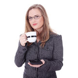Businesswoman in a suit drinking coffee or tea. Royalty Free Stock Image