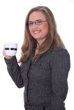 Businesswoman in a suit drinking coffee or tea. Stock Photos